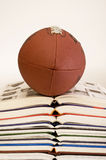 Football on stack of books Royalty Free Stock Image