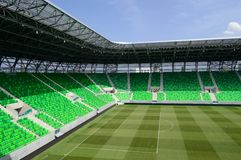 Football stadium. Arena with green stadium seats and grass, blue sky Royalty Free Stock Photo