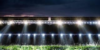 Football stadium background with flying ball. Soccer stadium background with flying ball royalty free stock image