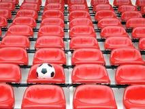 Football on stadium chairs. Game football on stadium chairs Royalty Free Stock Photo