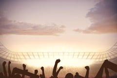 Football stadium with cheering crowd. Digitally generated football stadium with cheering crowd Stock Photos