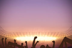 Football stadium with cheering crowd Stock Images