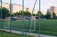 City children`s stadium. Football stadium in the early morning in a residential area of the city Stock Photos