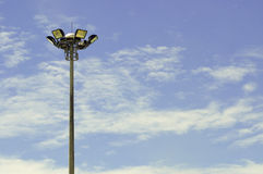 A football stadium floodlight , blue sky Stock Image