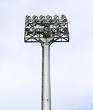 A football stadium floodlight with metal pole. Blue sky Royalty Free Stock Photo