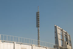 Football stadium floodlights. Are seen during daylight Royalty Free Stock Image