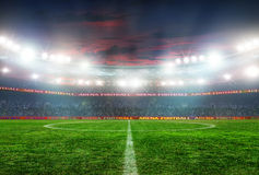 Football stadium before the game. Soccer ball on the field of stadium with light Royalty Free Stock Photography