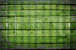Football stadium with gates painted on wood plank Royalty Free Stock Photo