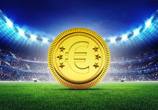 Football stadium with golden Euro coin Royalty Free Stock Image