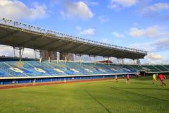 Football stadium with green grass Stock Photos