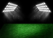 Football on the stadium lawn with light of searchlights Royalty Free Stock Photos