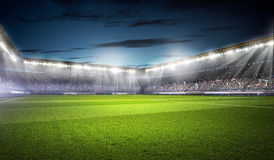 Football stadium in lights . mixed media Stock Photography