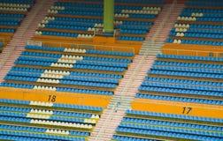 Football stadium seats in stadium of guangzhou. Blue and white football stadium seats viewed from above Royalty Free Stock Photos
