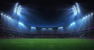 Modern grass field stadium night floodlight illumination zoom out footage stock video footage