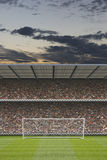 Football stadium stand with crowd, goal posts Stock Image