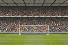 Football stadium stand with crowd, goal posts Royalty Free Stock Images