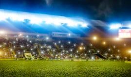 Football stadium, tribunes with fans, shiny lights stock image