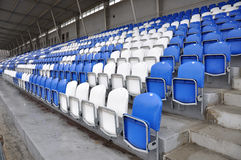 Football stands. With white and blue seats Stock Images