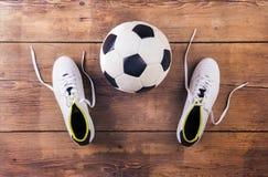 Football stuff on the floor Royalty Free Stock Photo