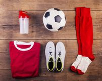 Football stuff on the floor Royalty Free Stock Photos