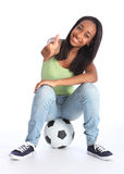 Football success for happy young teenage girl royalty free stock images