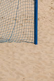 Football summer sport. goal net on a sandy beach Stock Photos