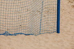 Football summer sport. goal net on a sandy beach Stock Photos