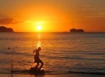 Football at sunset Stock Image
