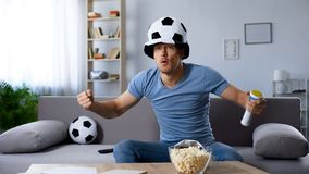 Football supporter in fan hat waiting for decisive penalty kick, championship. Stock photo royalty free stock photos