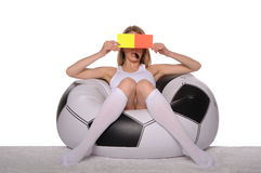 Football supporter with red and yellow cards Stock Photo