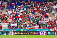 Football supporters. BARCELONA - SEPTEMBER 4: Unidentified mexican and chilean supporters during the friendly match between Mexico and Chile, final score 1 - 0 Royalty Free Stock Photography