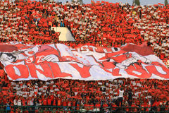 Football Supporters Pasoepati action while supporting his favorite team Persis Solo Stock Image