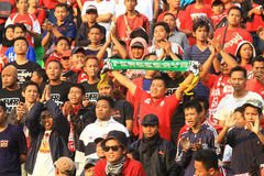 Football Supporters Pasoepati action while supporting his favorite team Persis Solo Royalty Free Stock Images