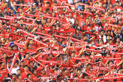 Football Supporters Pasoepati action while supporting his favorite team Persis Solo Stock Images