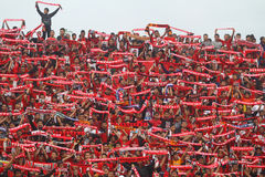 Football Supporters Pasoepati action while supporting his favorite team Persis Solo Stock Photography