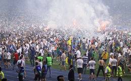 Football supporters run out into the pitch. KYIV, UKRAINE - JUNE 4, 2015: FC Dynamo Kyiv supporters run out into the pitch to celebrate the winning after Cup of Stock Photo