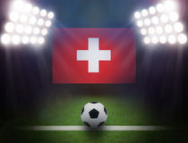 Football with Switzerland Flag in stadium. Royalty Free Stock Images