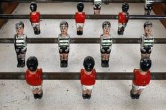 Football Table. Closeup of old miniature metallic ball players of a football table game Stock Photos