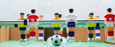 Football Table. Foosball colored plastic ball players royalty free stock image