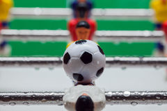 Football Table. Foosball colored plastic ball players stock photo