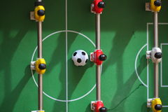 Football Table. Foosball colored plastic ball players royalty free stock photo