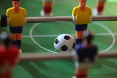 Football Table. Foosball colored plastic ball players stock photography