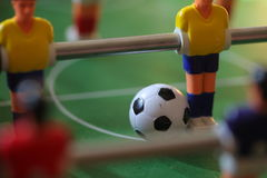 Football Table. Foosball colored plastic ball players royalty free stock photography