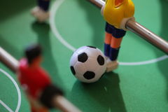 Football Table. Foosball colored plastic ball players royalty free stock images