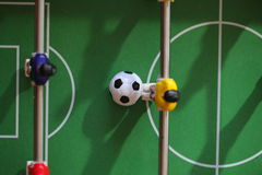 Football Table. Foosball colored plastic ball players royalty free stock photos