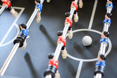 Football table game players suggesting team coaching Stock Photo