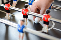 Football table game players suggesting team coaching. Or training Royalty Free Stock Photo