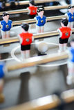Football table game players suggesting team coaching Royalty Free Stock Photos