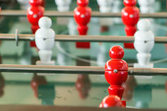 Football table game with red and white player . Royalty Free Stock Images