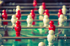 Football table game with red and white player Royalty Free Stock Photo